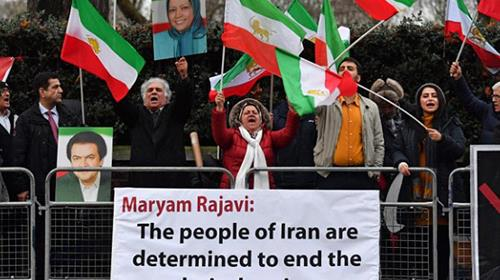 Protesters gather in front of the Iranian Embassy in London, supporting anti-government demonstrations in Iran.