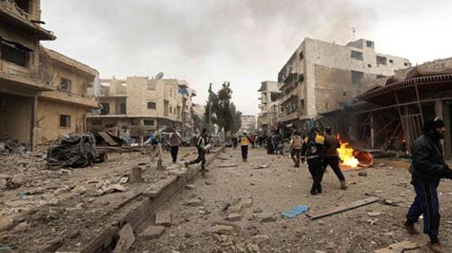 Civilians and members of the Syrian Civil Defence check the scene of a air strike on the city of Maaret al-Nuaman in Syrias rebel-held Idlib countryside