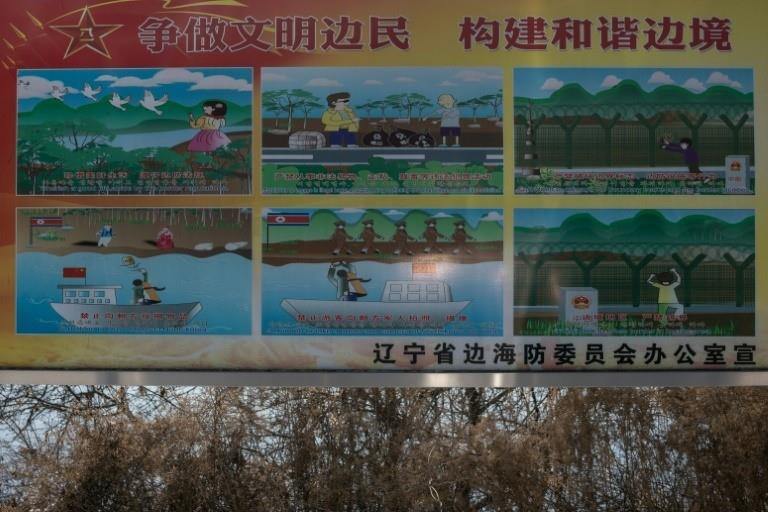 A sign in Dandong gives instructions on how to behave near the North Korean border - including no smuggling or taking photos of troops