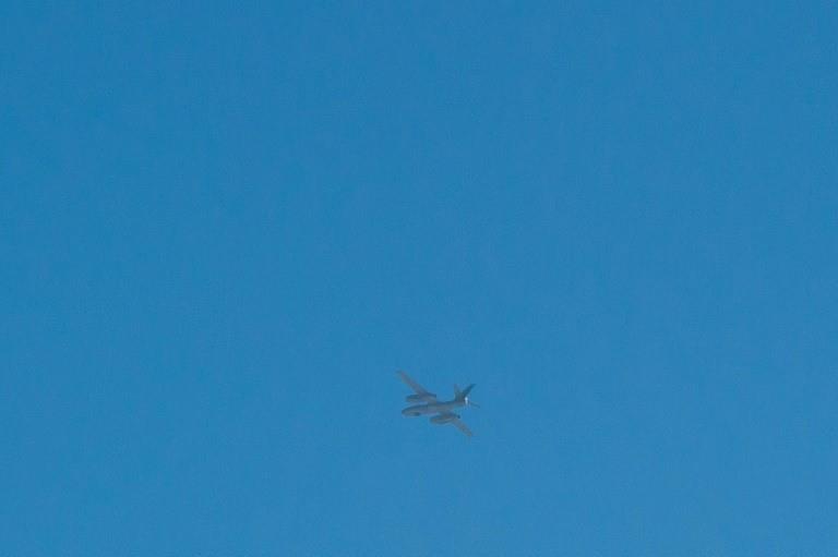 A light bomber flies over the North Korean town of Sinuiju