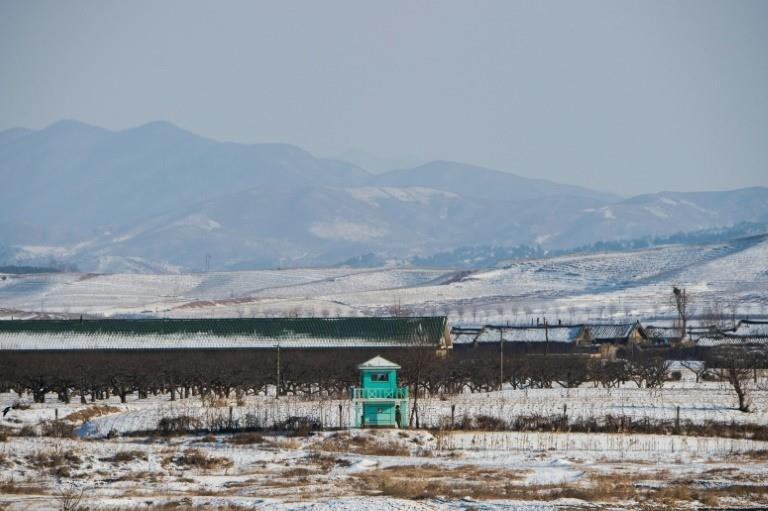 North Korean soldiers are seen at a guard post on the bank of the Yalu river