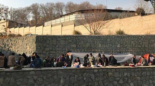 Families of arrested gather outside the notorious Evin Prison in Tehran