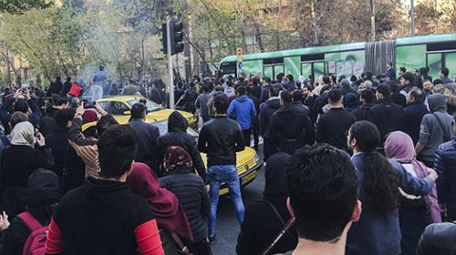 University students attend a protest inside Tehran University