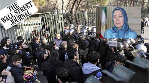 شرطة مكافحة الشغب الإيرانية تمنع طلاب الجامعة من الانضمام إلى غيرهم من المحتجّين في طهران، إيران، 30 ديسمبر 2017. الصورة وكالة أنباء أسوشيتد برس