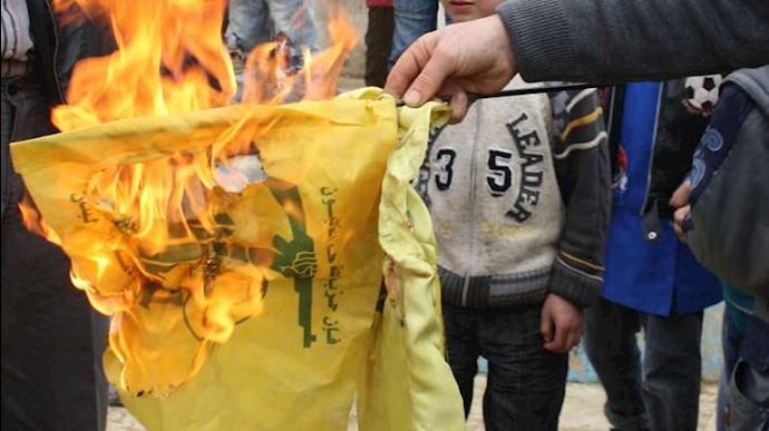 آتش زدن پرچم حزب الله  لبنان توسط شیعیان درروستای بریتال سوریه