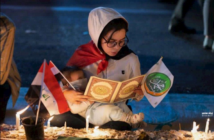 مادری به همراه کودکش - میدان تحریر بغداد ۲۳آبان۹۸