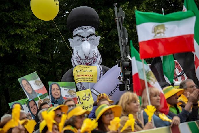 بازتاب خبرگزاری فرانسه از تظاهرات بزرگ مجاهدین در برلین-۱۵تیر۹۸(۷)