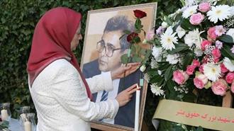 گلگذاری بر تصویر شهید بزرگ حقوق بشر دکتر کاظم رجوی