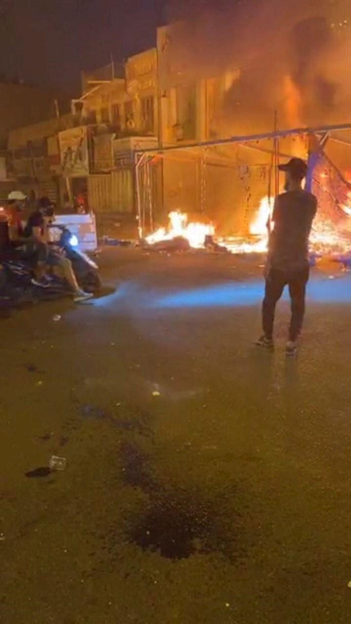درگیری در عراق،کشته و زخمی شدن تظاهرات کنندگان و آتش زدن چادرهای انقلابیون در میدان تحریر بغداد - 10