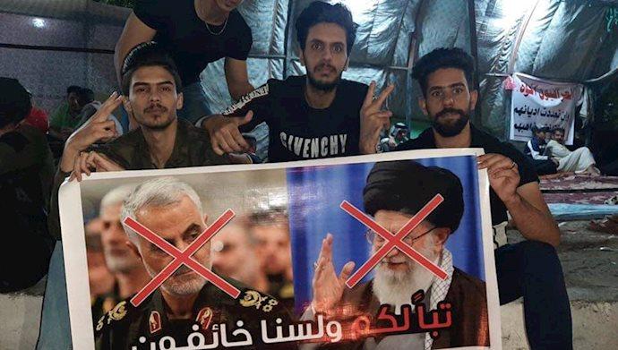 تخریب تصاویر خامنهای و قاسم سلیمانی در بغداد - عکس از آرشیو