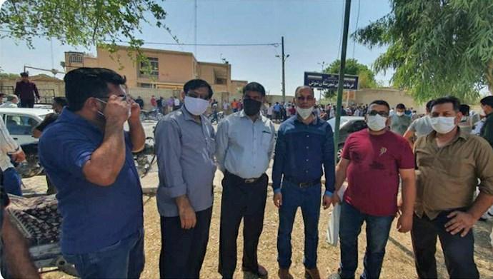 تجمع کارگران بازنشسته میان آب در شوش