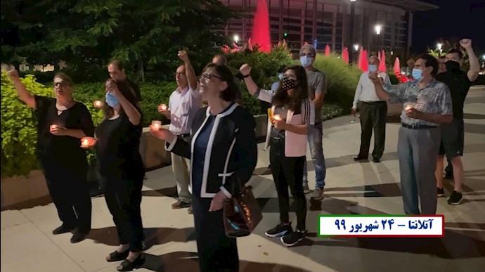 آکسیون اشرف نشانها در آتلانتا دراعتراض به اعدام نوید افکاری