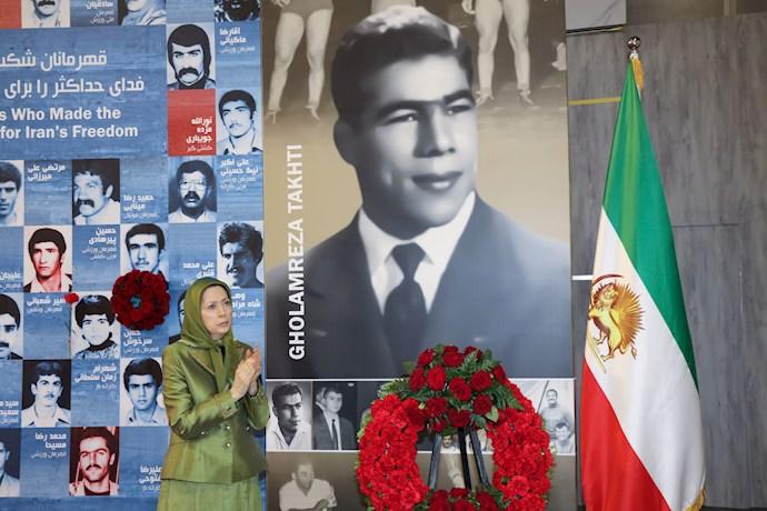 مریم رجوی - گلگذاری بر تصویر قهرمان ملی شهید نوید افکاری - 0