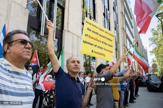 خبرگزاری فرانسه: تظاهرات حامیان شورای ملی مقاومت در بروکسل همزمان با اجلاس سران ناتو - 1