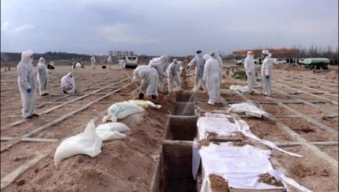 دفن فوتیهای کرونایی - عکس از آرشیو